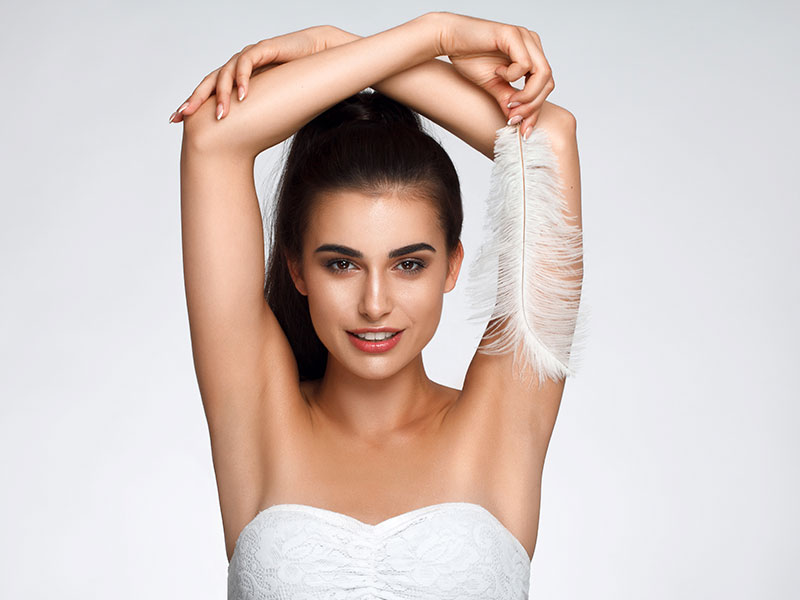 Beautiful Woman With Waxed Armpits And Feather