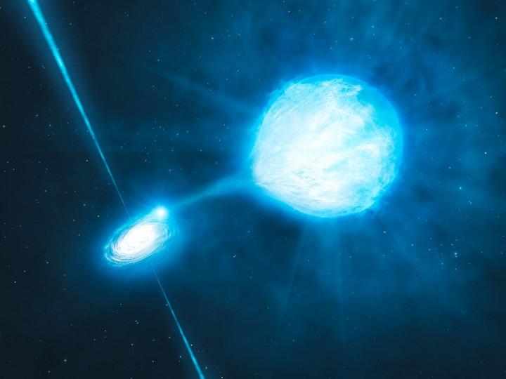 Ilustração do buraco negro estelar NGC 300 X1, encontrado na galáxia NGC 300, orbita em um sistema binário junto com uma massiva estrela de Wolf Rayet que ejeta suas camadas externas, contribuindo para o aumento da massa do buraco negro por acresção. Crédito: ESO/L. Calçada