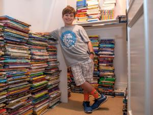 Ethan Posner, 9, with some of the 6,000 books he and his family has collected. Ethan Posner was diagnosed with acute lymphoblastic leukemia in 2014 and found reading to be great solace while hospitalized at CHOC.  Ethan started both a lending and gifting  library at CHOC called Ethan and Choco's Book Club.  He also  does short daily video book reviews on YouTube and continues his cancer treatment. Posner was photographed on Monday, November 7, 21016.  (Photo by Ana Venegas, Orange County Register/SCNG)