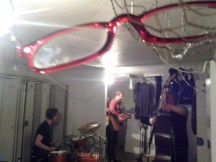 These red glasses were hanging from the ceiling in the downstairs locker room where the band was playing.