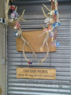 """This hung inside the cow paddock. A """"snudd"""" is a pacifier. The sign says, """"Will you let the foals have your pacifier?"""""""