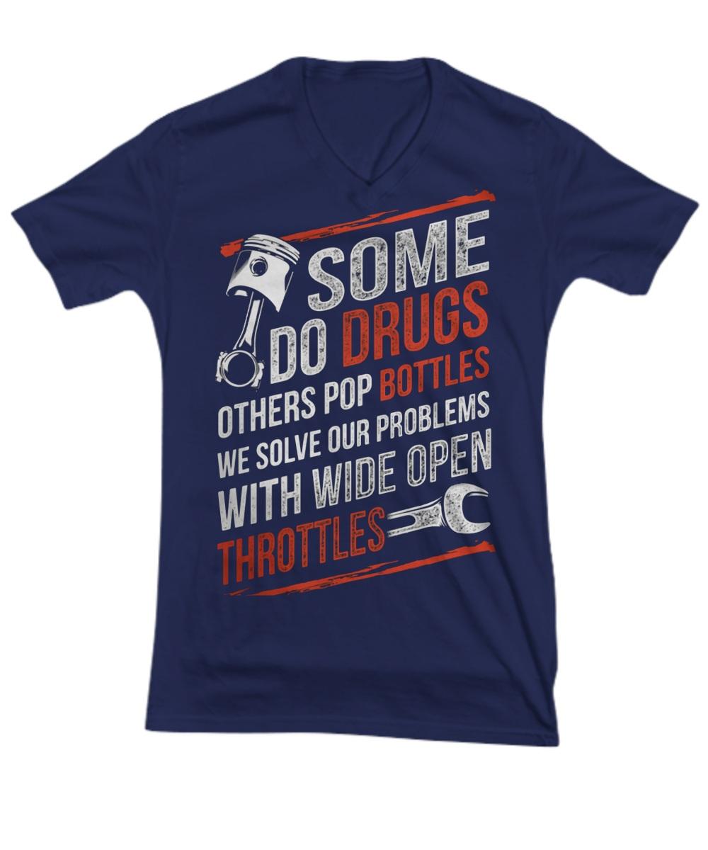 Some do drugs others pop bottles we solve our problems V-neck