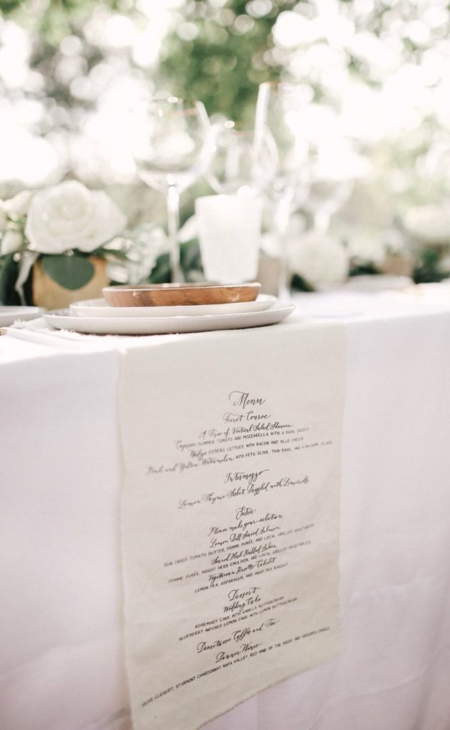 minimal paper used at this ethical wedding, manus printed on fabric on tables