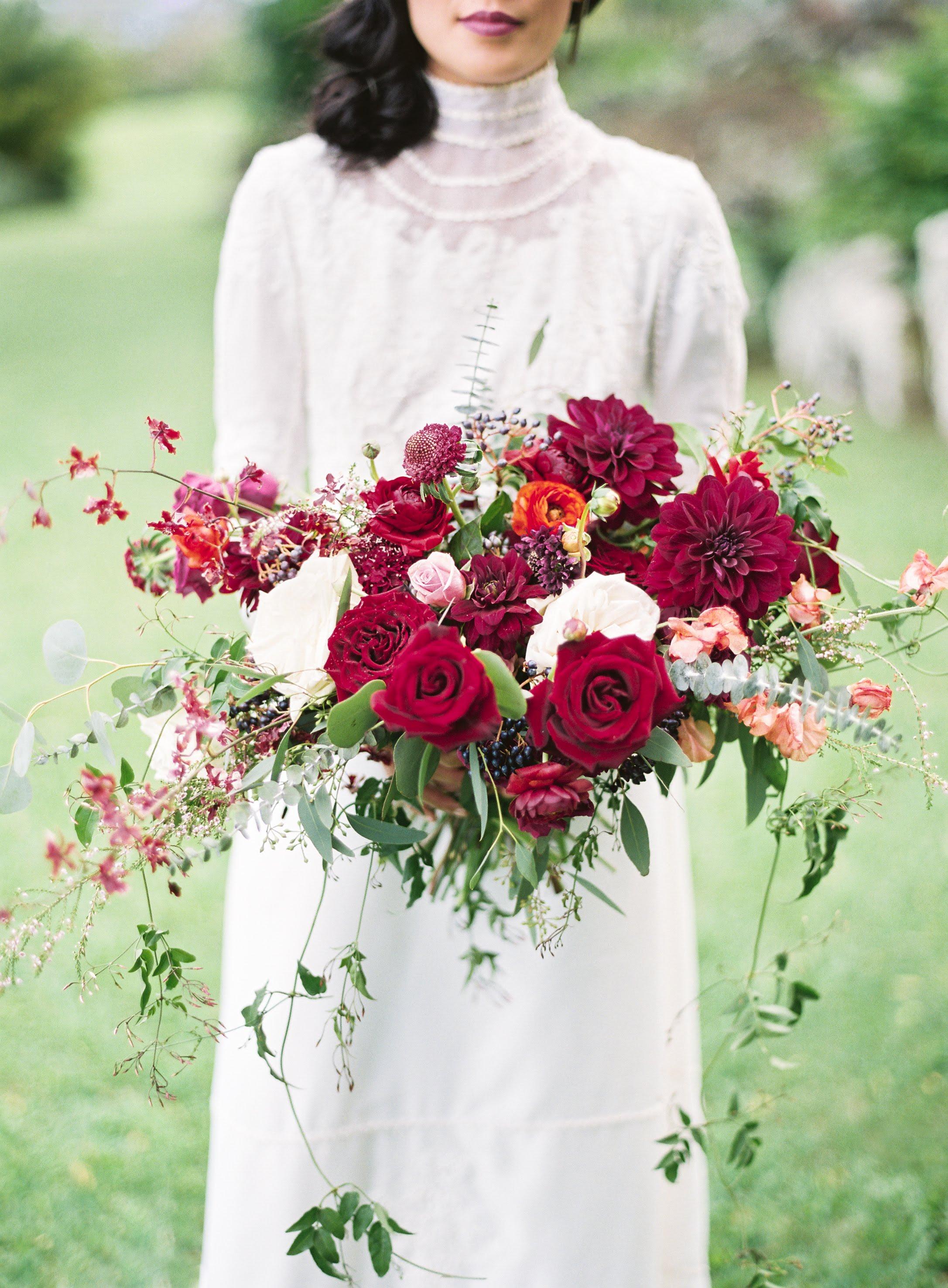 Up close of bride holding floral arrangement