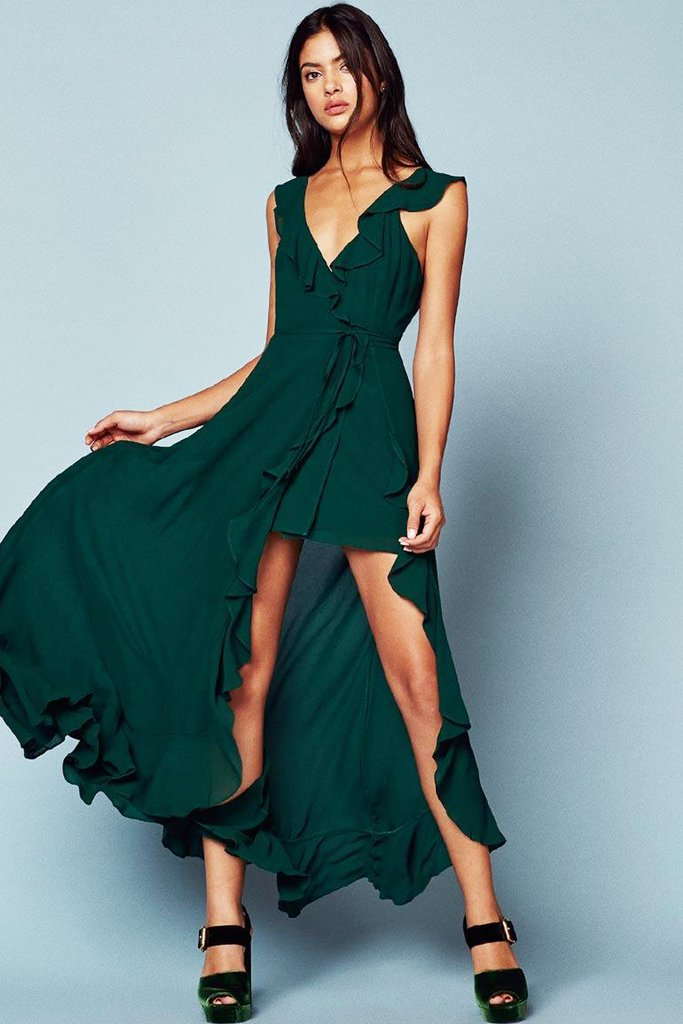 A gorgeous green ruffled dress rental from Reformation that's perfect for ethical wedding fashion!
