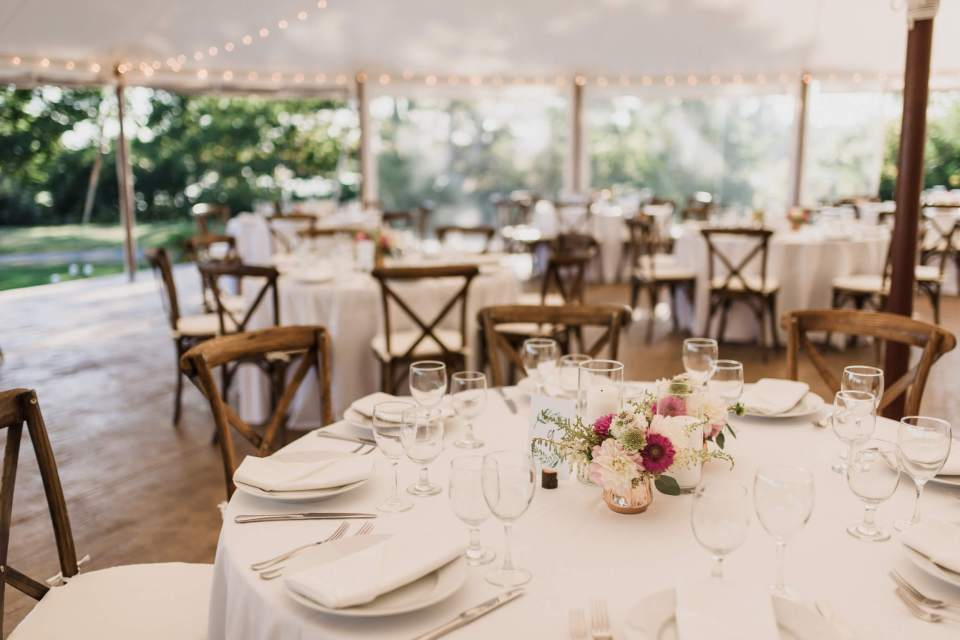 The beautiful ceremony under the tent at this intimate waterfront wedding.