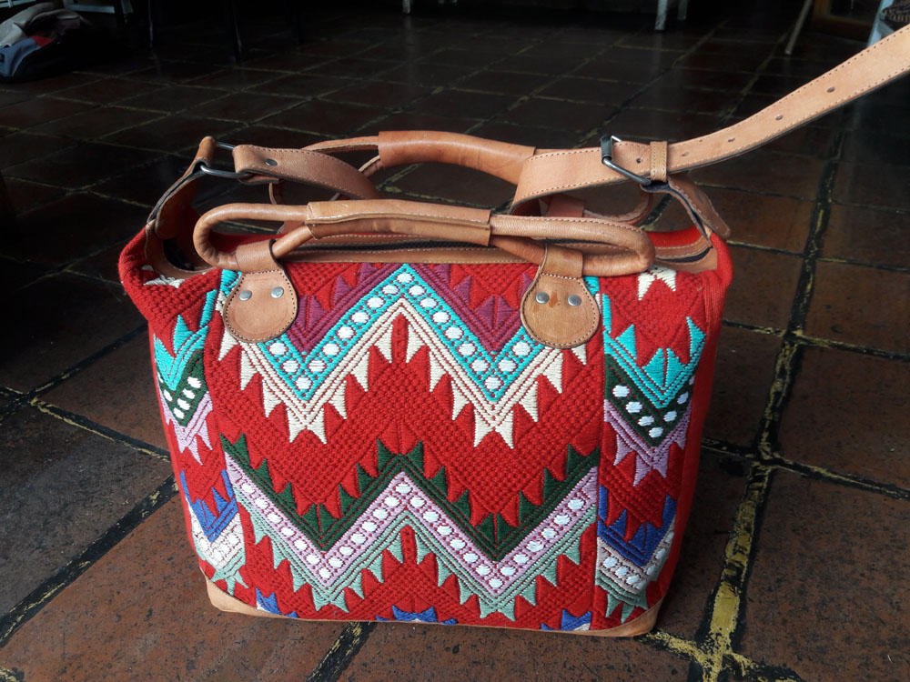 Guatemalan Handmade Huipil Style Bag with handmade patterns and 3 exterior pockets.