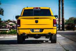 yellow pick up truck on grey concrete road