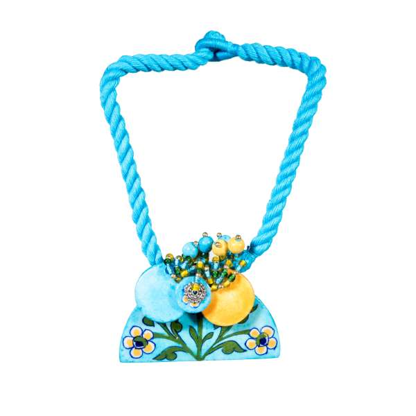 handmade blue pottery boho jewellery sold by Ethiqana a shop specialising in eco friendly products, earth friendly products and sustainable products.