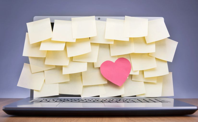 """Post-Its covering laptop screen."" Licensed from Shutterstock."