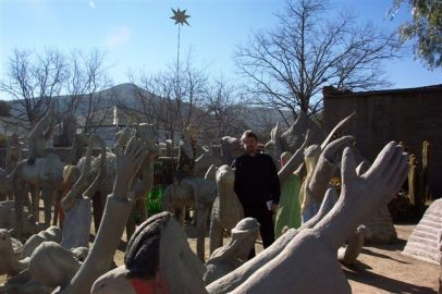 """In the Camel Yard of the late Helen Martins's Owl House, Nieu-Bethesda. She is regarded as a prominent outsider artist. When Van Heerden was a child and visited his grandmother in Nieu-Bethesda, he was often warned not to talk to """"the witch""""."""