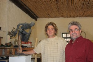 With sculptor Paul Boekkooi, Nieu-Bethesda, and his interpretation of the angel in The Long Silence of Mario Salviati, 2010.