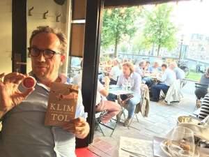 Dutch publisher Joost Nijsen (Podium Publishers, Amsterdam) with Etienne van Heerden's 1964 Coca-Cola yo-yo and the Dutch edition of Klimtol.