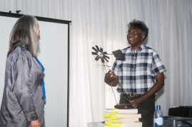 Lien Botha presents Darryl David with the Order of the Windmill as recognition for his initiatives and hard work as organiser of many festivals around the country. (Photo: Amy Coetzer)