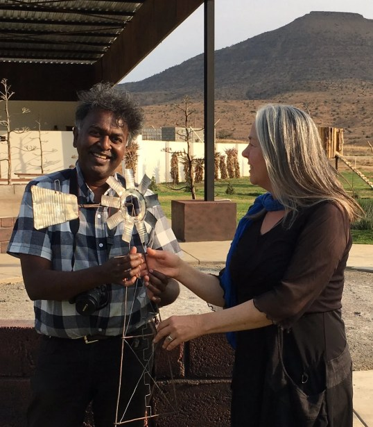 Lien Botha presents Darryl David with the Order of the Windmill in recognition of his initiatives and hard work as organiser of many festivals around