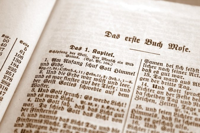The opening chapter of Genesis in an old German Bible. Courtesy of Max Pixel, https://www.maxpixel.net/Page-God-Book-Antique-Old-Paper-Bible-Font-Holy-3180262