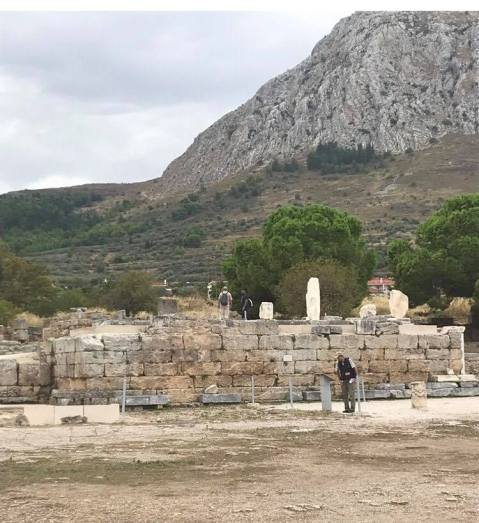 The 'Bema' of Corinth. It is probably from this platform that Gallio declared he would take no further action against Paul. The crowd would have beaten Sosthenes in the open space before it. Behind is a rock known as Akrokorinth, which had a temple dedicated to Aphrodite at the top of it.