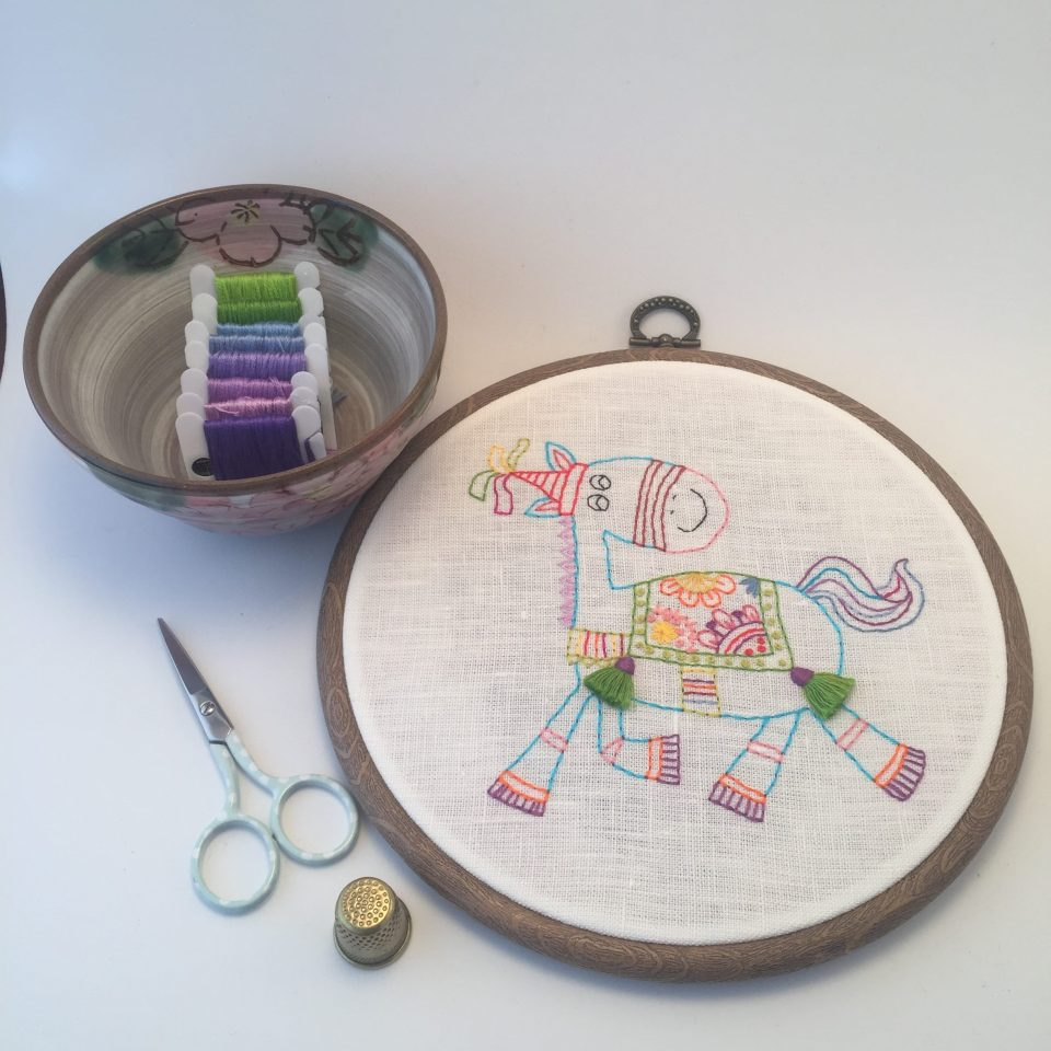 Happy horse hand embroidered picture in a hoop for nursery decor