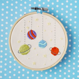 Hand embroidery with planets