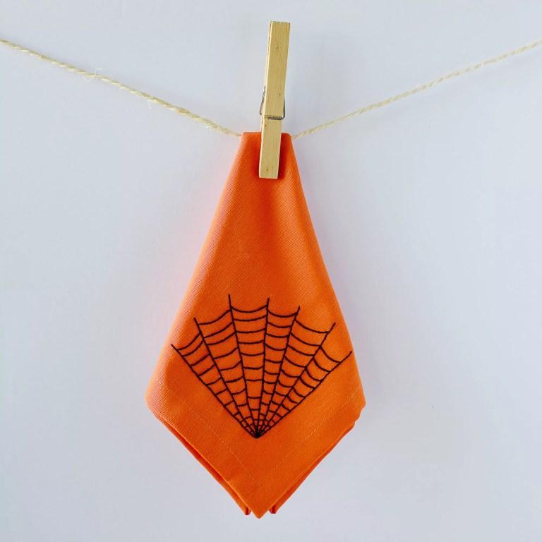 Halloween cobweb design embroidered on a fabric napkin