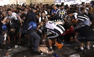 Panic in Turin: Hundreds injured in soccer game bomb scare stampede