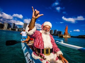Canoe-surfing Santa Claus is coming… to Outrigger's Waikiki resorts