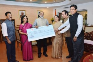 India Tourism Minister receives dividend check from ITDC