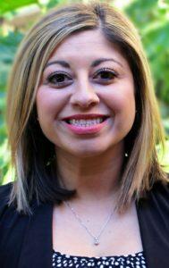 Benchmark names Fatima Molina Global Revenue Support Center Director, TX