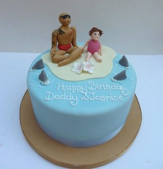 beach father and daughter birthday cake