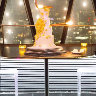 Tumbling yellow rose wedding cake at the Gherkin London