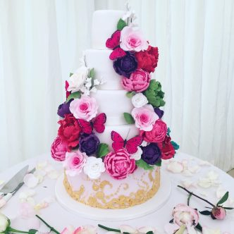 Vibrant Flower and Gold Wedding Cake