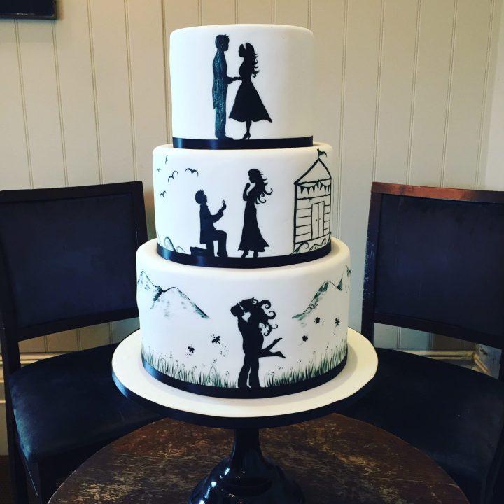 Beach and mountain silhouette wedding cake