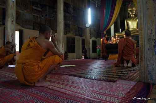 Buddhist monks praying in Wat Bo Temple, Siem Reap, Cambodia