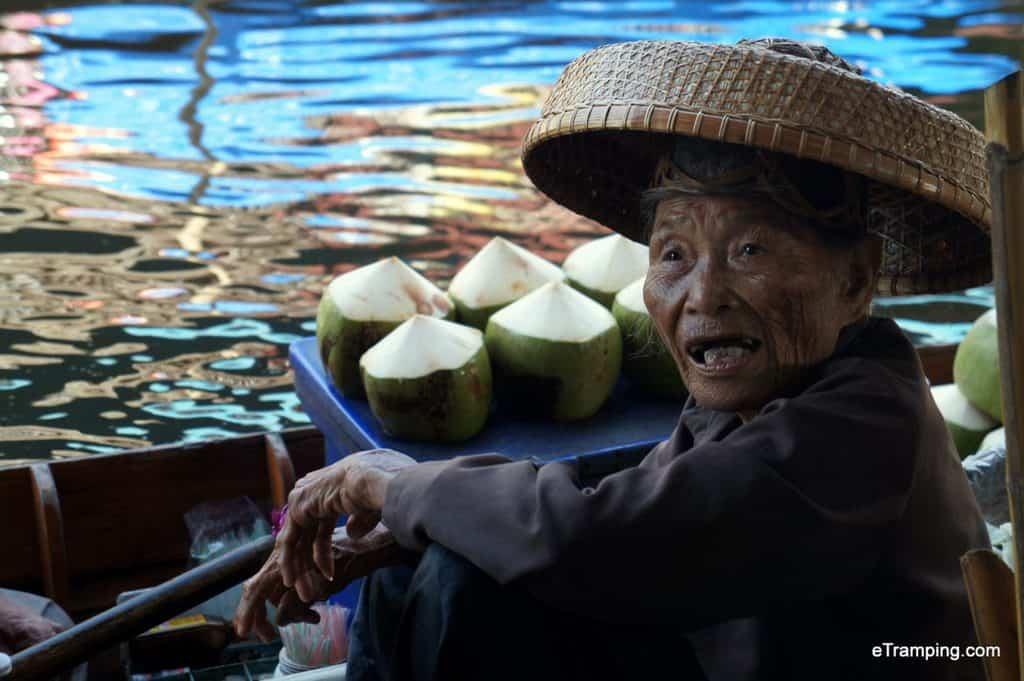 Thai woman selling dumplings at the Floating Market in Bangkok