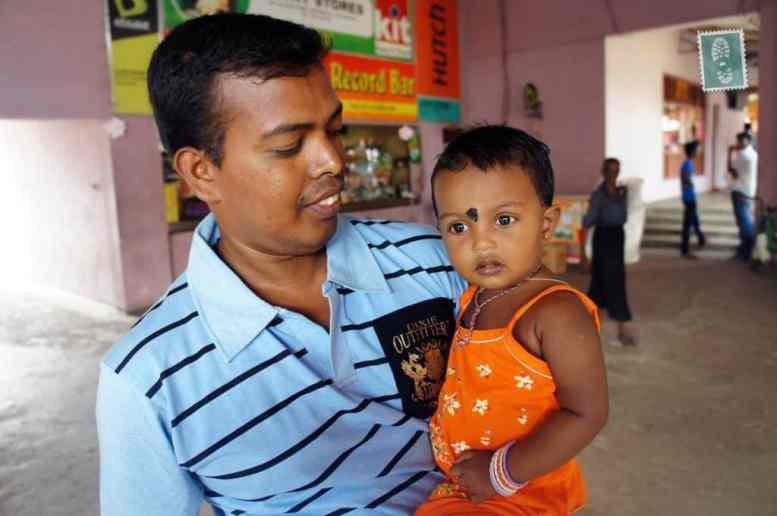 Sri Lankan man is holding his child