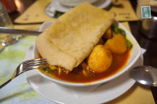 A plate of Chicken roti