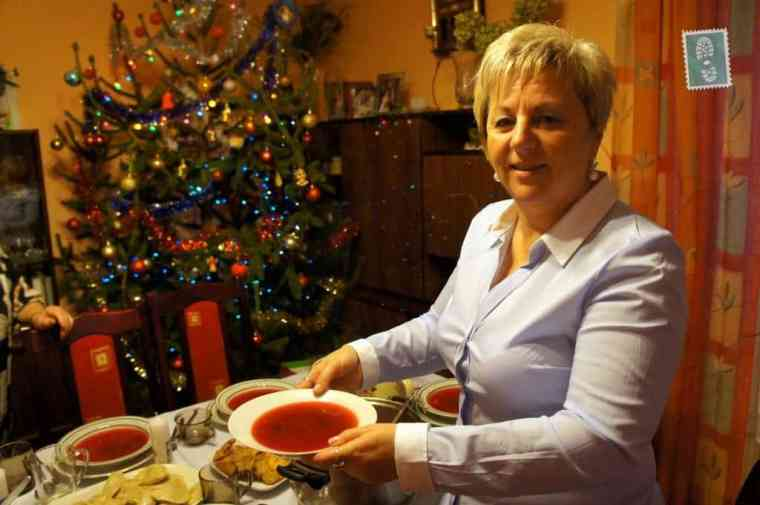 Agness's mom pouring some Polish borscht (barszcz) recipe includes red beetroot, onions, garlic, and other vegetables, such as carrots and celery or root parsley.
