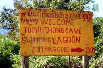 Sign pointing to Swimming Lagoon in Vang Vieng (jumping good)
