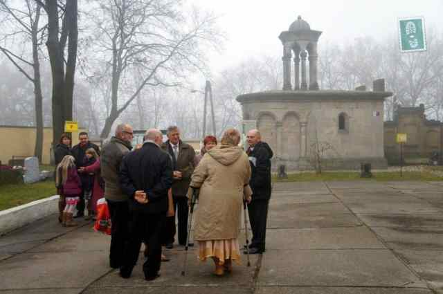 Friends and family gather together in front of the church