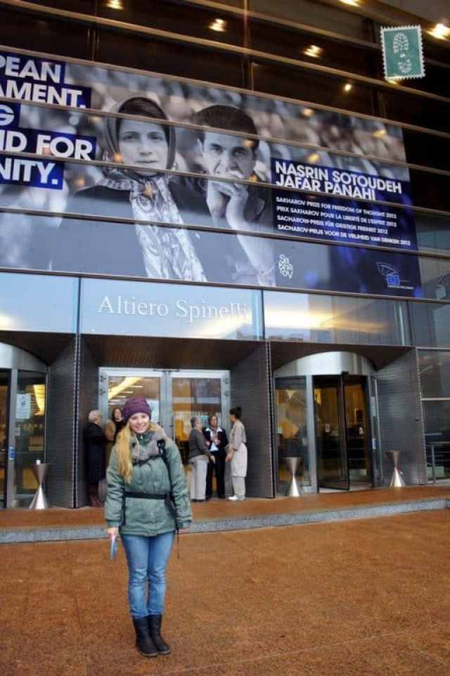 A girl standing in front of the European Parliament