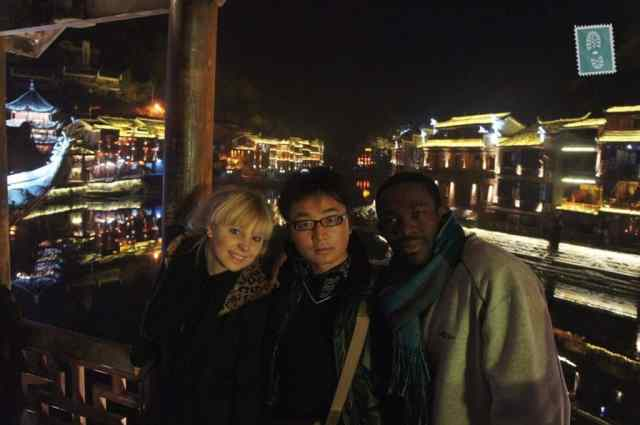 3 people in Fenghuang. A white girl, black guy and Chinese guy