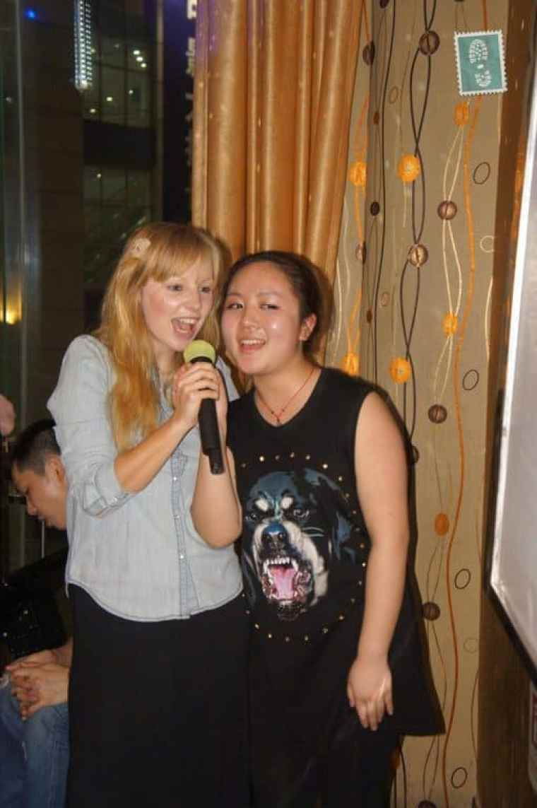 two girls one chinese one polish are singing a karaoke song