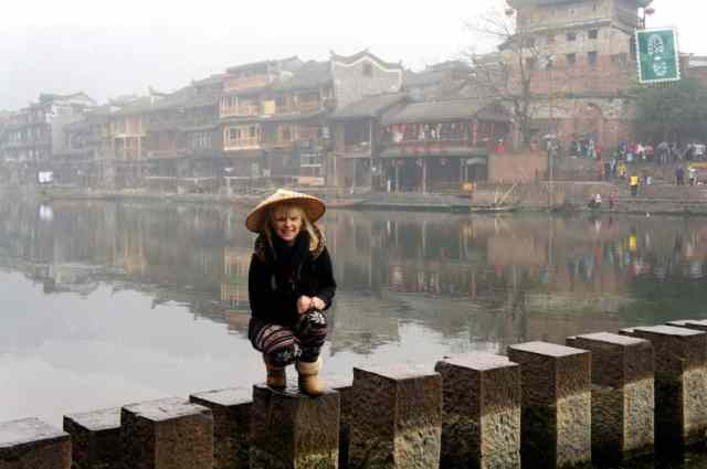 Fenghuang a girl is standing on the bridge