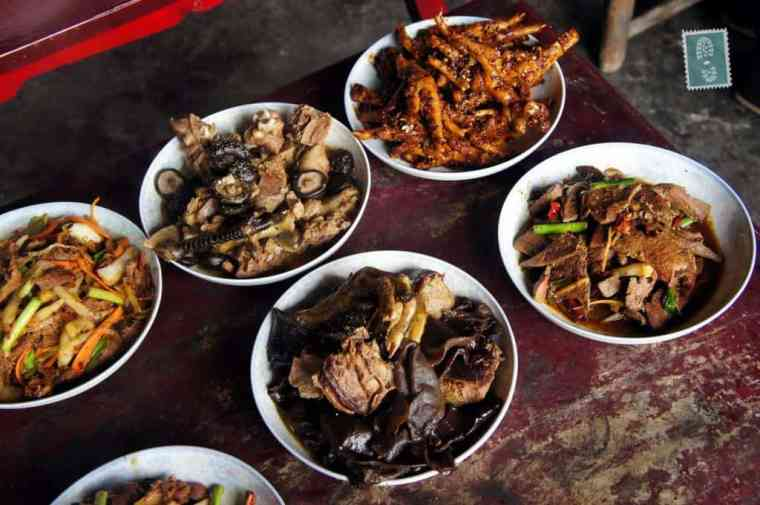 Chinese New Year's food - spicy chicken's legs, mushrooms, all edible parts of pig and chicken with fried veggies