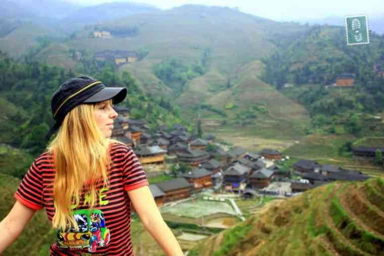 A girl is exploring Longji Terraced Fields in Guangxi Province