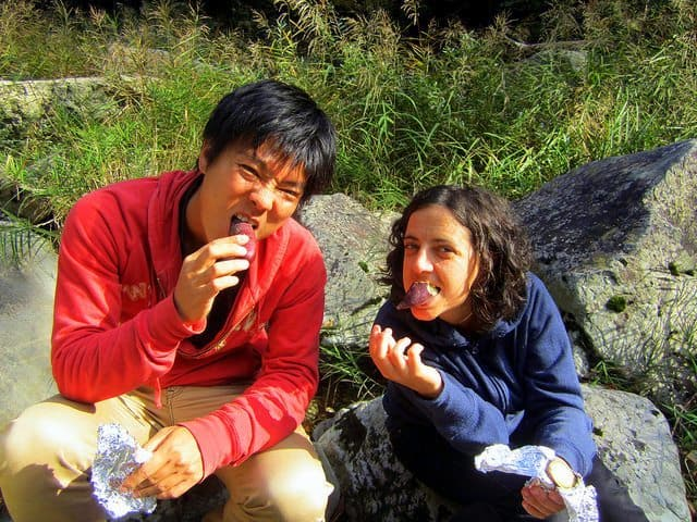Enjoying our lunch break sitting on a rock by the river with our CS host, Hiroshima, Japan