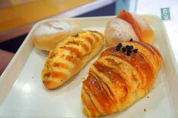 chocolate croissant, had bun, garlic bread and mini cheese soft baguette
