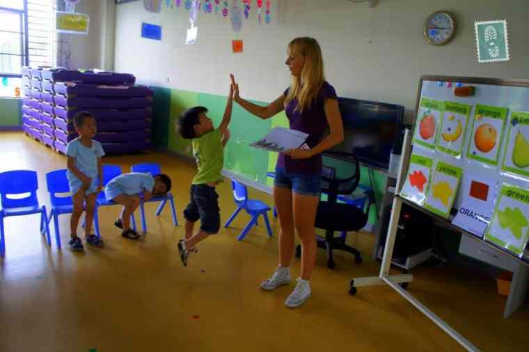 A foreign teacher and high five with Chinese students