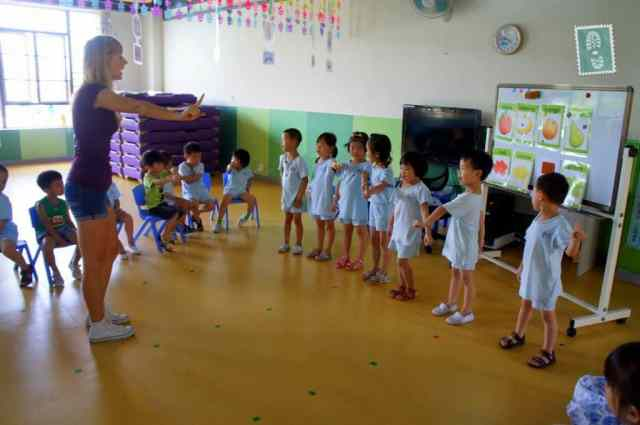 A foreign teaching is teaching students a new song