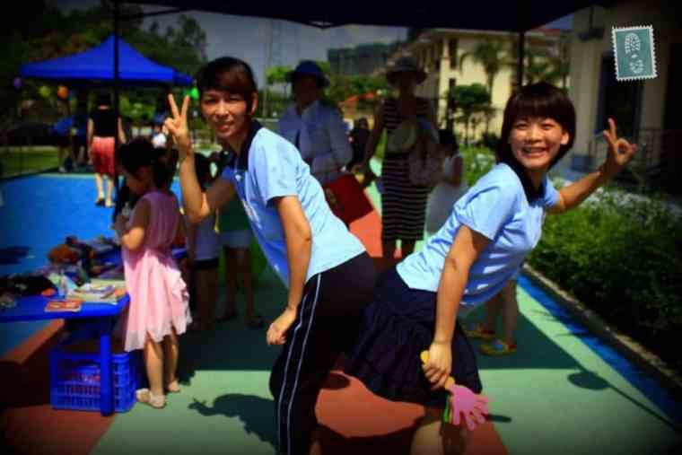 Two Chinese girls are posing for a photo